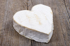 Heart shaped Neufchatel cheese on a table Stock Photo