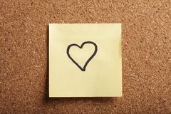 Heart-shaped note Stock Images