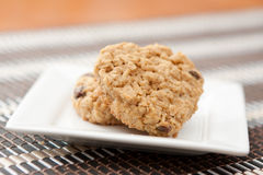 Heart-shaped oatmeal cookies. Heart shaped oatmeal cookies on a white square plate Royalty Free Stock Photos