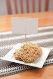 Heart-shaped oatmeal cookies with Sign. Heart shaped oatmeal cookies with a sign on a white square plate Stock Photography
