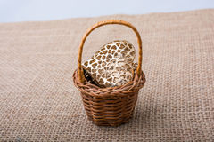 Heart shaped object in a basket Royalty Free Stock Image