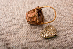 Heart shaped object beside a basket Stock Images