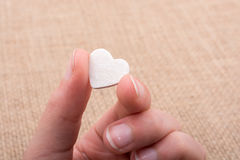 Heart shaped object in hand Stock Photo