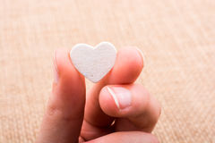 Heart shaped object in hand Stock Photography