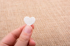 Heart shaped object in hand Royalty Free Stock Image