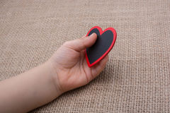Heart shaped object in hand Royalty Free Stock Images