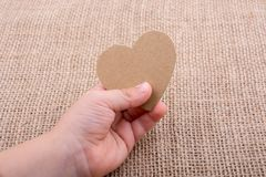 Heart shaped object in hand Royalty Free Stock Photo