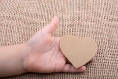 Heart shaped object in hand Stock Image