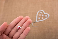 Heart shaped object in hand Stock Images