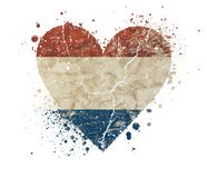 Heart shaped grunge vintage flag of Netherlands. Heart shaped old grunge vintage dirty faded shabby distressed Dutch Holland, Kingdom of the Netherlands national royalty free stock photo