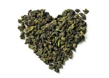 Heart shaped of oolong tea on white background stock photo