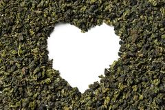Heart shaped of oolong tea on white background. stock photo