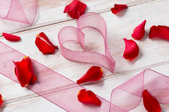 Heart-Shaped Organza Gauze and Fresh Rose Petals Stock Photos
