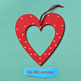 Heart-shaped ornament and text tis the season Stock Images