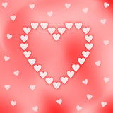 Heart shaped out of pink hearts on iridescent background Royalty Free Stock Photo