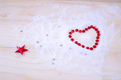 Heart shaped out of red star ornaments Royalty Free Stock Image