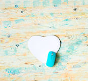 Heart shaped pad with mouse on wooden background Stock Images