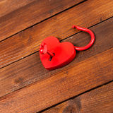 Heart shaped paddock open. Paddock on wooden background with a key Royalty Free Stock Images