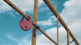 Heart shaped padlock. Heart shaped padlock on metal railing of bridge stock video footage