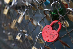 Heart shaped Padlock. A heart shaped padlock (love lock) has been locked at Ponts des Arts in the French capital Paris next to a dozen of other locks Stock Images