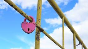 Heart shaped padlock. Heart shaped padlock on metal railing of bridge stock footage