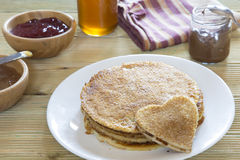 Heart shaped pancake on stack of pancakes Stock Image