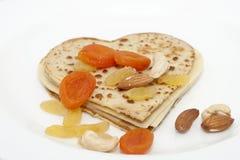 Heart-shaped pancake on white Royalty Free Stock Photos