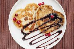 Heart shaped pancakes with chocolate Royalty Free Stock Photography