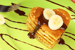 Heart shaped pancakes with chocolate sauce and banana Stock Image