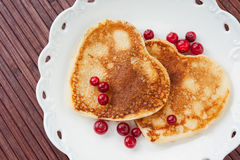 Heart shaped pancakes with cranberries on plate Stock Photo