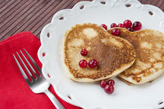 Heart shaped pancakes with cranberries on porcelain plate. Close Stock Photography