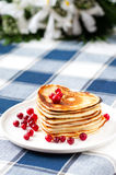 Heart shaped pancakes with cranberries on porcelain plate. Close Stock Image