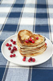 Heart shaped pancakes with cranberries on porcelain plate. Close Stock Photo