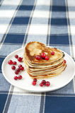 Heart shaped pancakes with cranberries on porcelain plate. Close Royalty Free Stock Photos