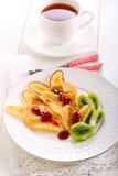 Heart shaped pancakes with strawberry jam Stock Image