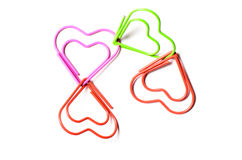Heart shaped paper clips connected to each other Stock Photos