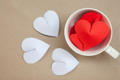 Heart-shaped paper in coffee cup Arrange as background. This is the symbol of love. For in February 14th, a day of love Stock Image
