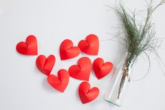 Heart-shaped paper and glass jar Arrange as background. This is the symbol of love. For In February 14th, which was a day of love Royalty Free Stock Photography
