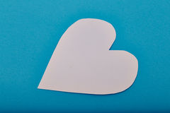 Heart shaped paper note. Pink Heart shaped sticky note on the blue background stock images