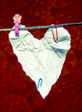 Heart shaped paper sheet on a clothes line Royalty Free Stock Photo