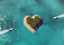 Heart Shaped Paradise Island. Great vacation background with a heart shaped island Stock Photography