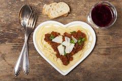 Heart shaped pasta. Dish on wood royalty free stock photo