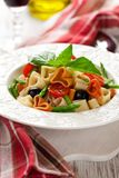 Heart-shaped pasta with vegetables Royalty Free Stock Image