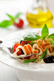Heart-shaped pasta with vegetables Royalty Free Stock Photo