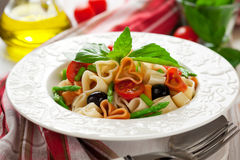 Heart-shaped pasta with vegetables Stock Photos