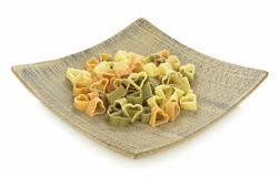 Heart shaped pasta on wooden plate Royalty Free Stock Images