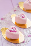 Heart shaped pastel pink chocolate mousse cakes Royalty Free Stock Images