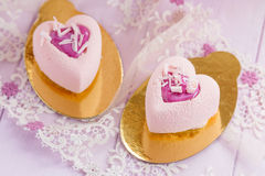 Heart shaped pastel pink chocolate mousse cakes Stock Photo