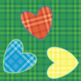 Heart-shaped patch sewn. Onto fabric plaid Royalty Free Stock Photo