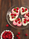 Heart Shaped Pavlova with Raspberries Stock Photos